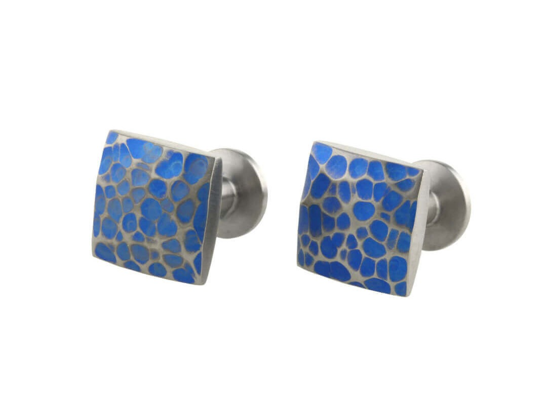 Planished square cushion cufflinks on TouchTitanium.com Strong, square and super light-weight cufflinks for men. Lathed from solid titanium bar. Each one is precision machined and hand finished for superior quality and lasting strength. Finished in a brushed texture.